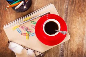 cup with notebook