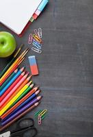 School supplies on blackboard background photo