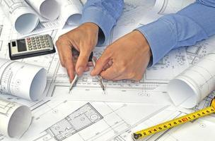 Hands and project drawings photo
