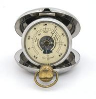 Old pocket barometer displaying fair weather. Closeup, isolated