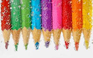 Pencils in water photo