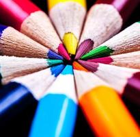 Macro of colored pencils in a circle. photo