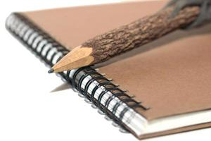 cuaderno y lápiz foto