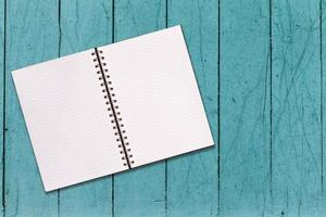 Note Book On Vintage Shabby Wood Background Wall Texture.
