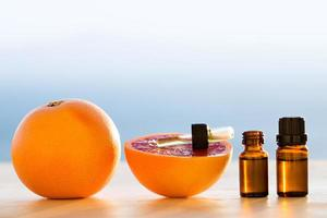 Grapefruit essential oils in bottles photo