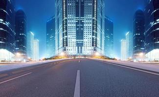 Asphalt road and modern city photo
