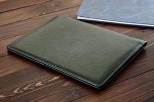 Green business leather folder closeup photo