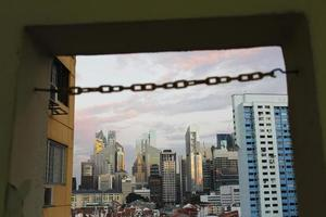 Chain link across Singapore skyline