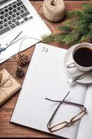 Cup of coffee with notebook and gifts