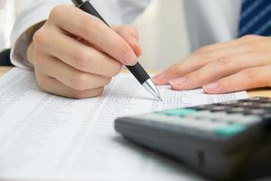 Businessman calculating the financial statements photo