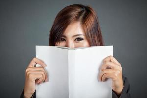 Close up of Asian business girl hold a book