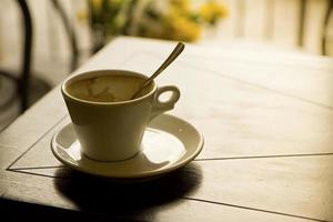 Empty coffee cup on table photo