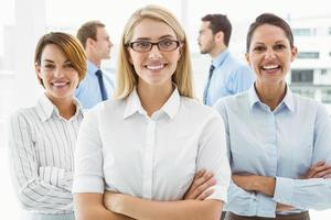 Young businesswomen with arms crossed photo