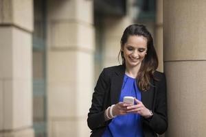 Business woman using a smart phone. photo