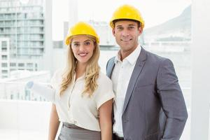 Portrait of colleagues wearing hard hats photo