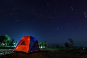 spiral star trail with campsite at night photo