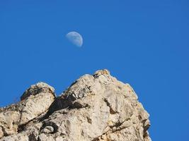 Moon in the mountains photo