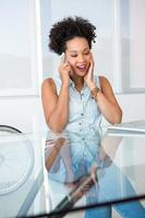 Young casual woman using cellphone
