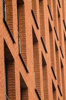 Orange brick wall with windows of modern building