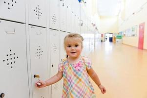 Little girl at school locker