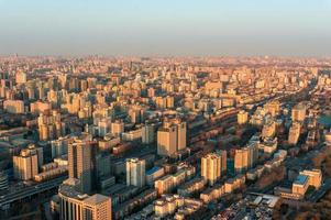 Aerial view of Beijing cityscape at golden hour photo