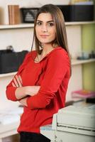 Relaxed young beautiful young business woman smiling photo