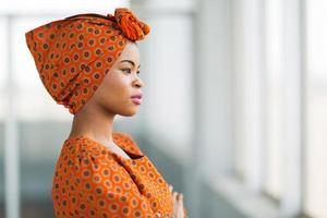 african businesswoman wearing traditional clothes photo