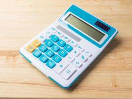 calculator on wood background