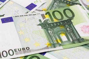 Money background - One hundred (100) euro bills banknotes photo