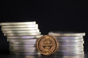 Turkish Kurush Ataturk Gold Coin in front Silver Coins photo