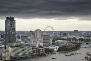 London city aerial view over skyline with dramatic sky photo