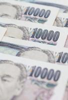 Stack of japanese currency yen or Japanese banknotes photo