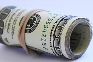 Roll of hundred dollar bills photo