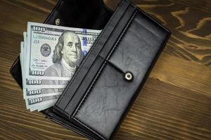 Wallet with hundred dollars