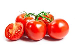 Closeup of tomatoes on the vine isolated