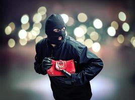 Thief stealing womans handbag