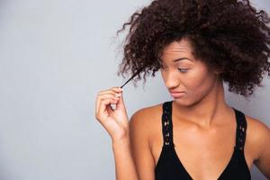 Portrait of afro american woman touching her hair photo