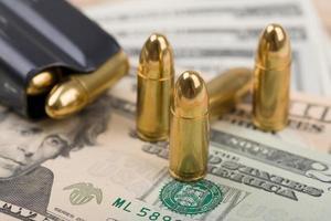 bullet on US dollar banknotes photo