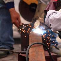 Workers welding