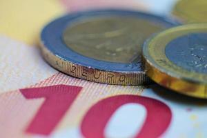 Euro coins and bills, macro photography.