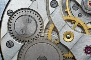 Metal Cogwheels in Old Clockwork, Macro. photo
