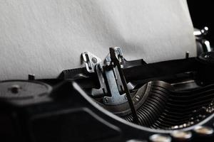 typewriter with aged textured paper sheet photo