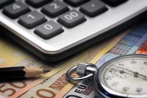 bills,chronometer and calculator photo