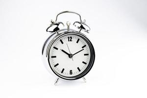 Metal Alarm clock, wake up time, on white background