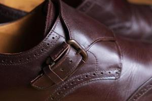 Buckle detail of a pair of classic brown Brogue shoes