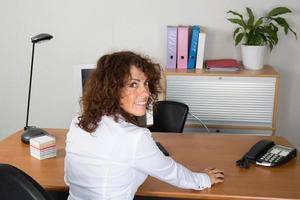 Woman at work with a white shirt happy to work photo