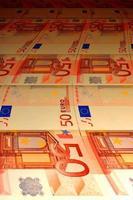 Fondo tortuoso de los billetes en euros