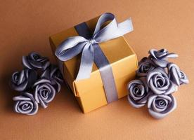 grey flowers and golden gift box photo