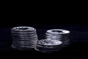 Silver coins in stacks.