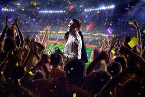 Fans on stadium game businessman photo